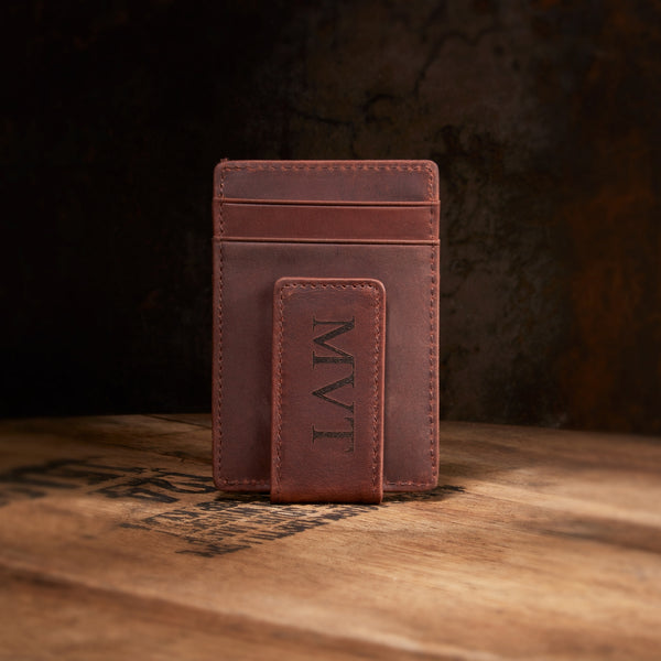 engraved money clip on whiskey barrell