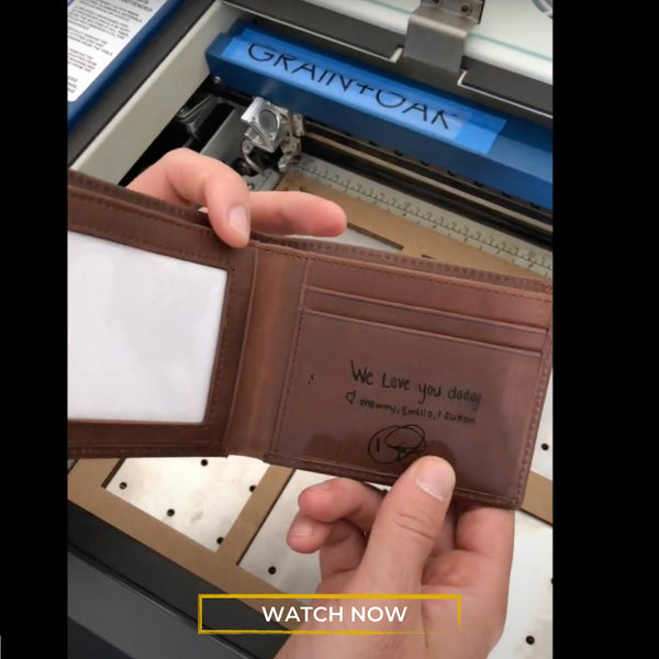 man holding engraved leather wallet