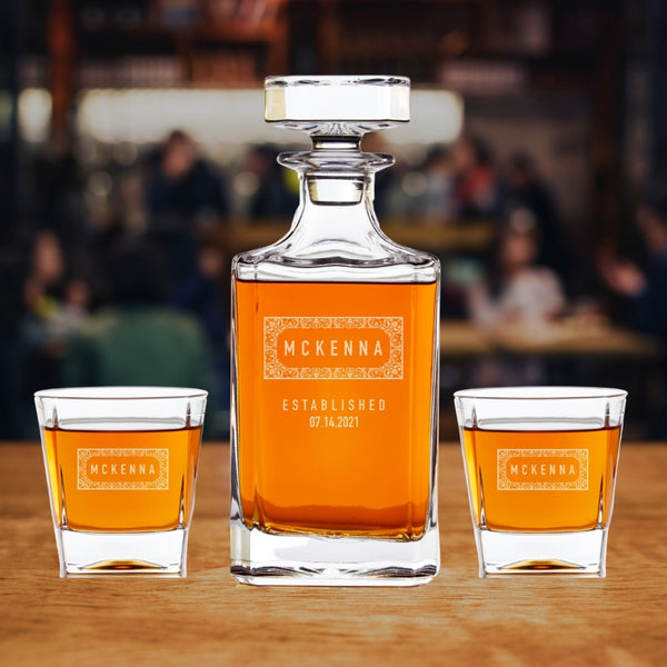 engraved whiskey decanter set on table