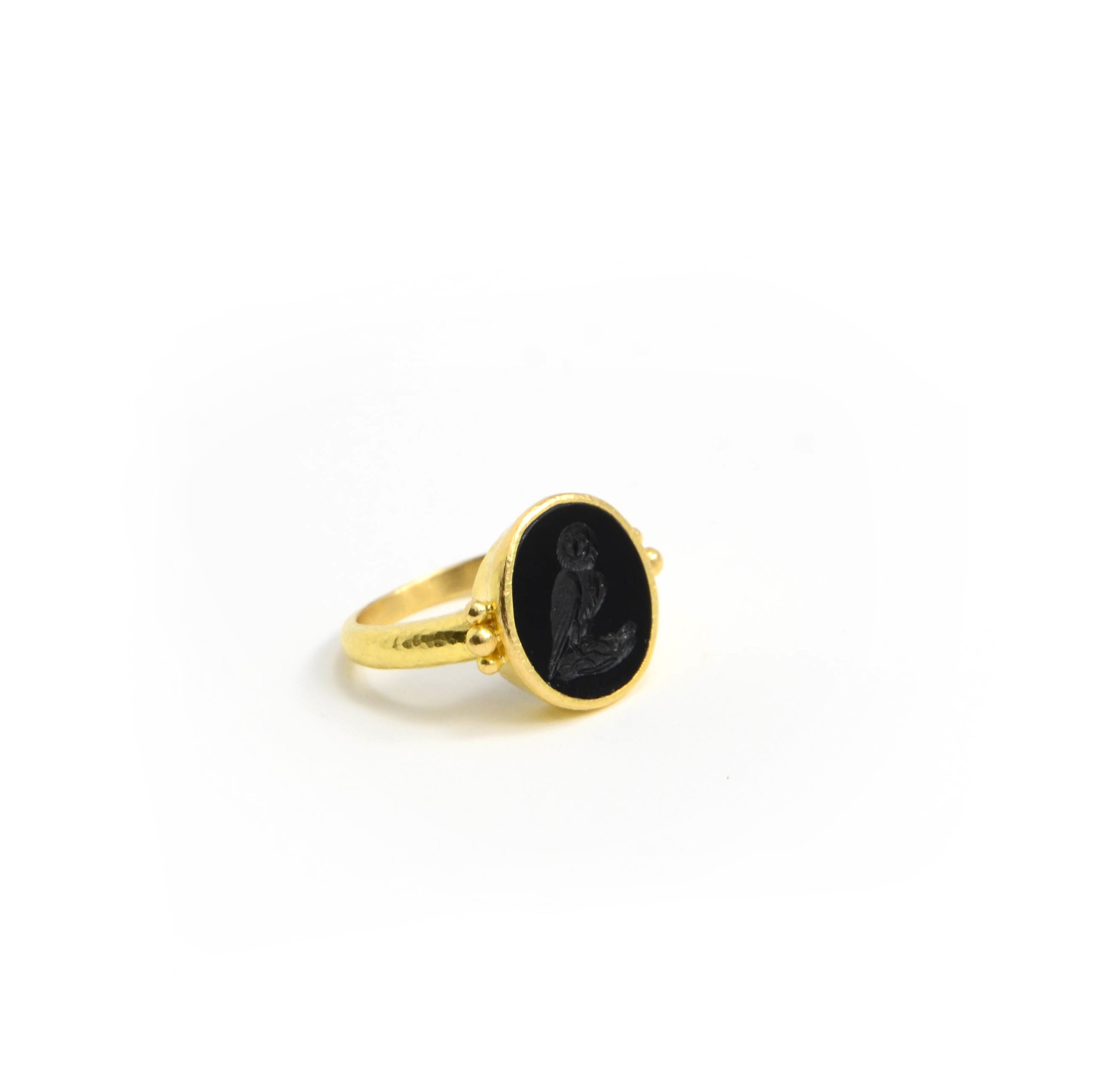 "Elizabeth locke jewels onyx ""owl"" intaglio ring. Oval intaglio set in 19 karat hand finished gold. triad details on narrow shank."