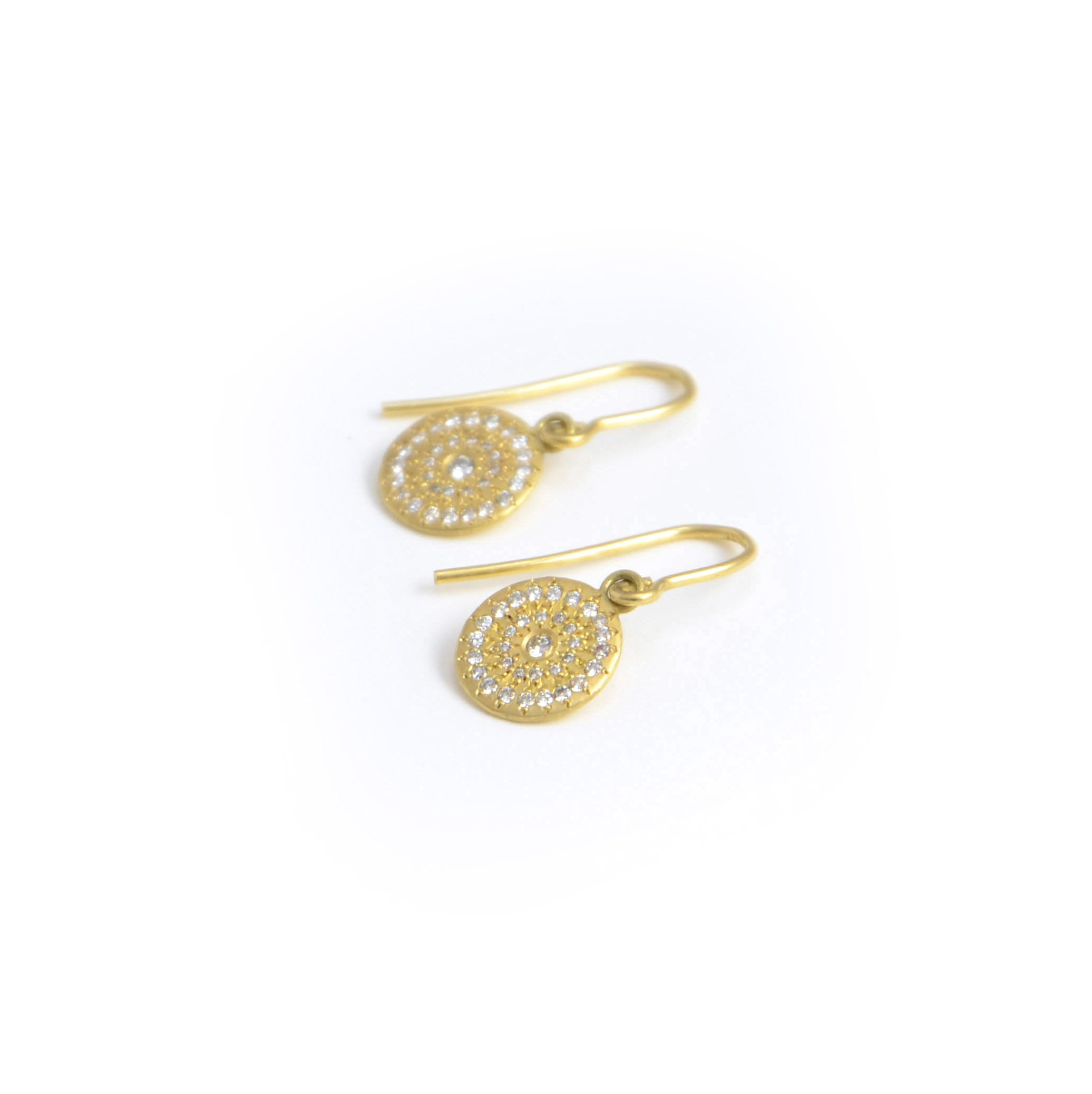 Adele Chefridi Earrings. Star Earrings with diamonds in concentric circular patterns. The 18 karat gold disks hang on wires.