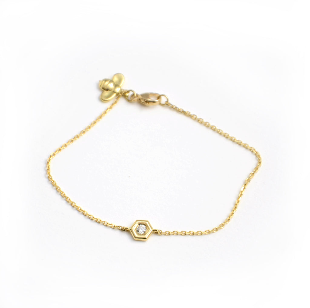 "gumuchian mini b bracelet with diamond set in gold ""cell"". 18 karat yellow gold."