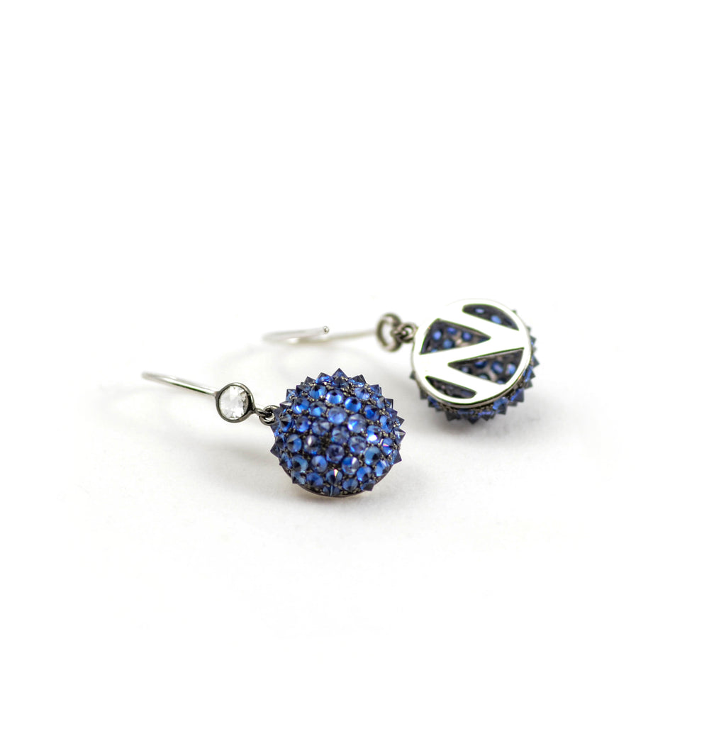"Nam Cho Spike Earring. A dome of white gold is encrusted with glittering blue sapphires. Bezel set white diamonds accent the top of the earring. All on French wire. Earring includes 3.4 TCW blue sapphires. Diameter is approximately  1/2' and height approximately 1.125"" from top of wire."