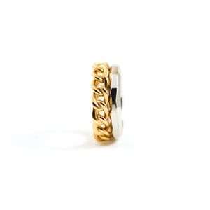 pomellato milano ring. Linked rose gold band adjacent to a faceted white gold band all in 18kt gold.