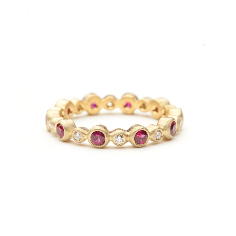 Annie Fensterstock Stepping Stone ring in 18 karat yellow gold with bezel set rubies and diamonds.