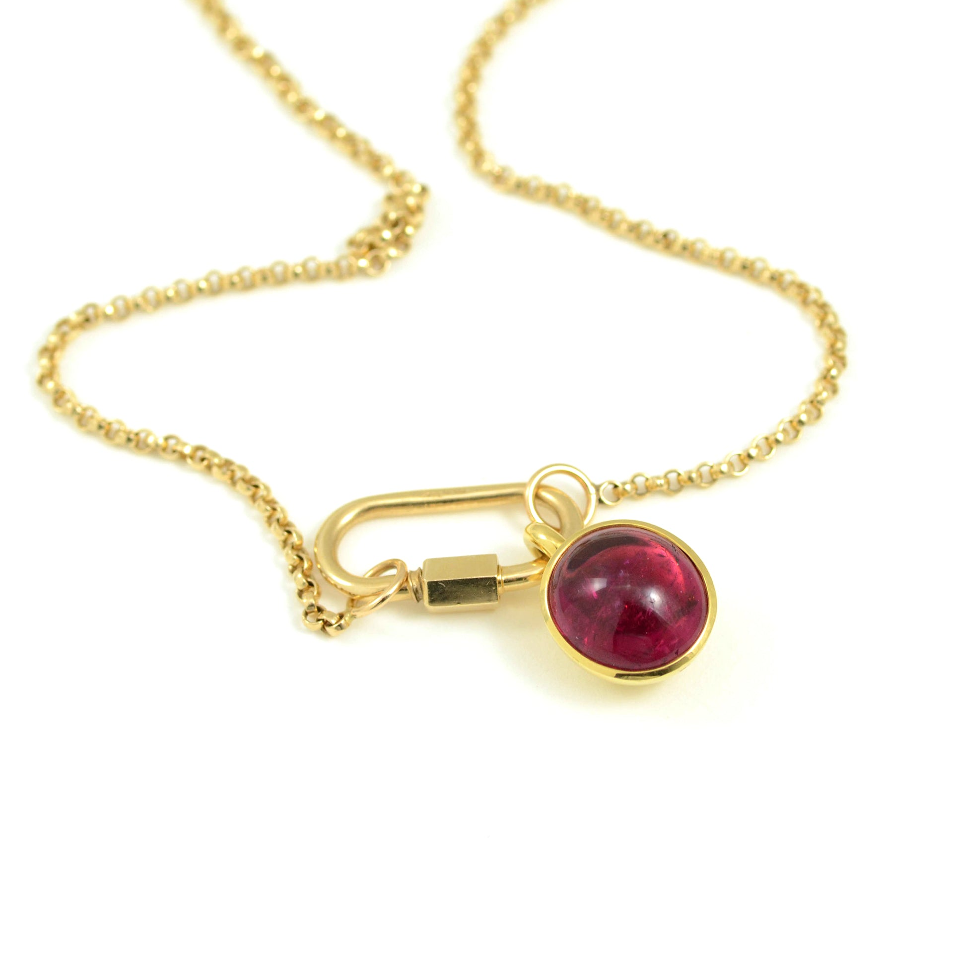 Erich Zimmerman Red tourmaline cabachon in 18kt yellow gold basket setting.