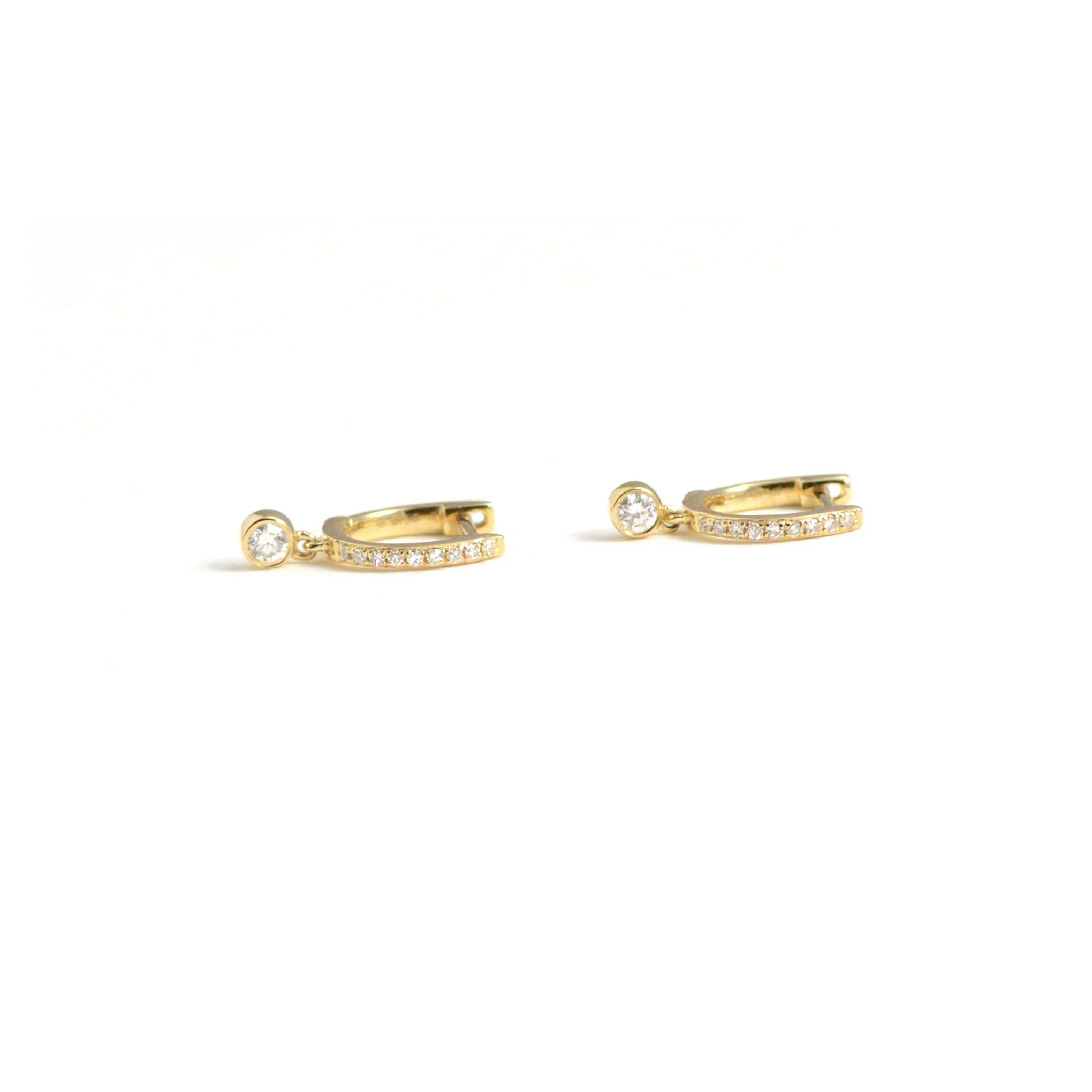 diamond mini huggies with diamond bezel drop in 14kt yellow gold