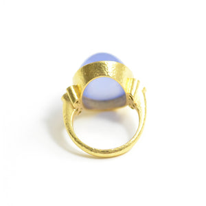 lizabeth Locke ring. Oval cabochon Blue chalcedony accented with six blue sapphires bezel set in 19 karat yellow gold. Interior view