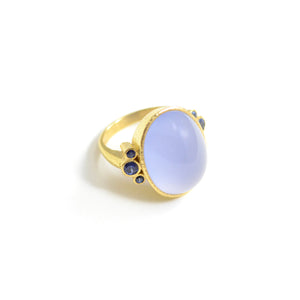 lizabeth Locke ring. Oval cabochon Blue chalcedony accented with six blue sapphires bezel set in 19 karat yellow gold.