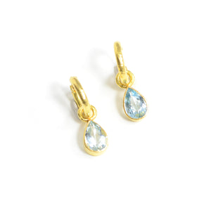 "Elizabeth Locke earring pendants. Shown here with ""Big Baby Hoops"" the faceted aquamarine teardrop pendants are bezel set in 19 karat gold."