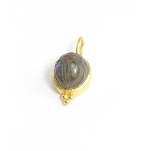 Elizabeth Locke pendant. Labradorite cabochon carved with scarab. Bezel set in 19 karat yellow gold with large bail.