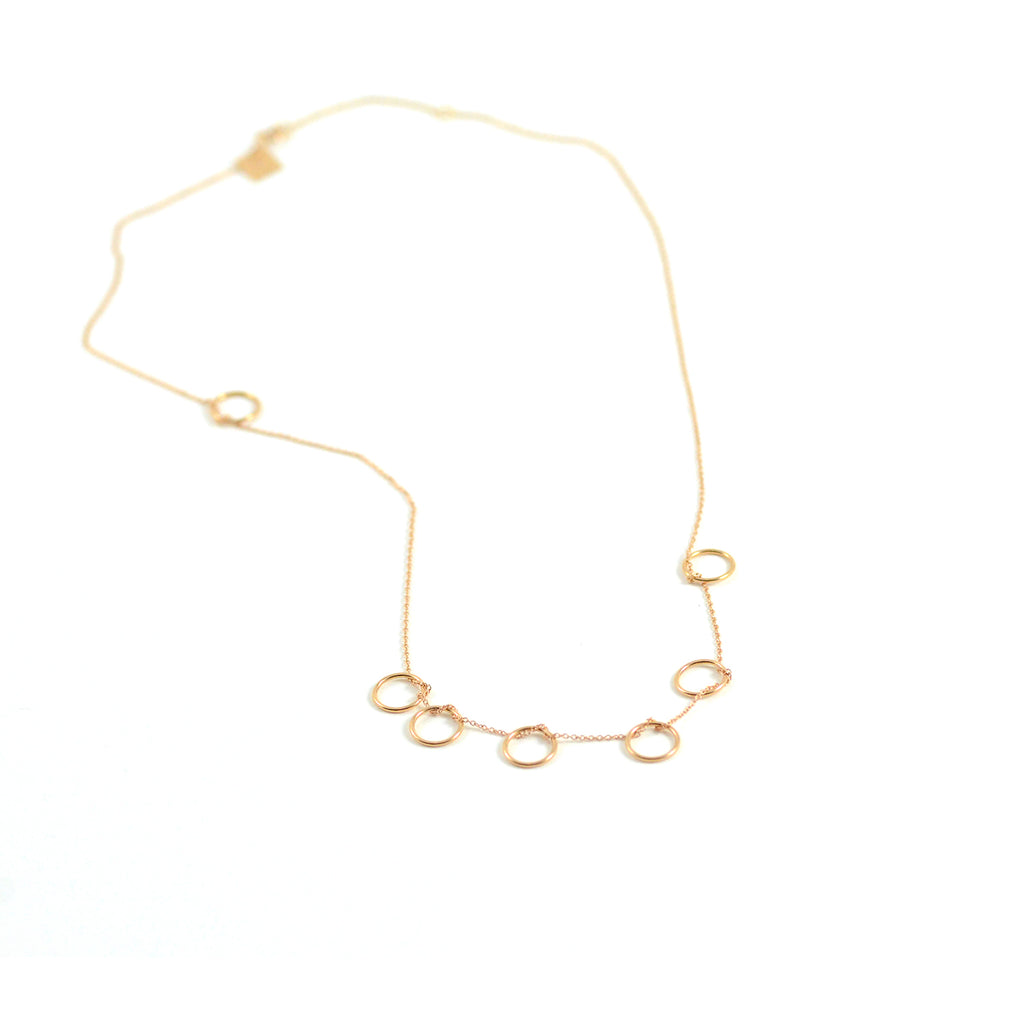 Ginette NY necklace seven circles 18 karat rose gold