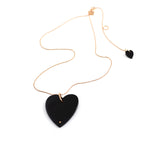 "Ginnette NY necklace. A luxuriously minimal necklace in Black Onyx and 18kt Rose Gold sparkling ball chain. A mini heart dangles discreetly at the back.  Chain adjusts from 17"" to 20"". Jumbo heart measures 1.57"" and .39""."