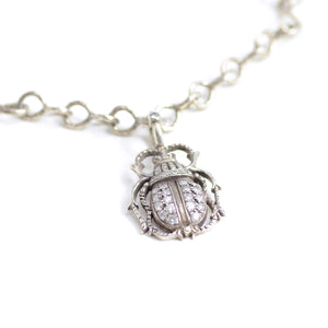 Irit Design pendant and necklace. Charming beetle rendered in silver and accented beautifully with diamonds is held by hammered silver chain.