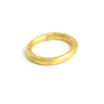thick gold band with diamonds. 24 karat gold and .10 TCW diamonds