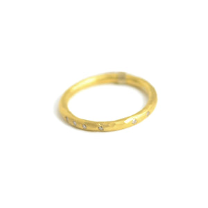 Lika Behar 22 karat narrow gold band with diamonds