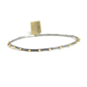 Lika Behar Mixed Metal Bangle with 22 bezel set diamonds.
