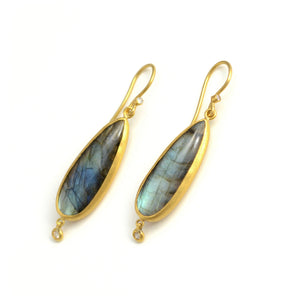 Lika Behar earrings. 24 karat gold surrounds these fiery labradorite stones. Bezel set diamonds accent the base of the earring.