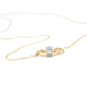 marla Aaron total baguette aquamarine baby lock shown on fine square link chain