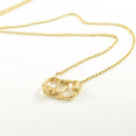 Marla Aaron yellow gold meander locks on Rolo chain