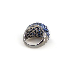 nam Cho spike ring. 18kt blackened white gold in reverse set blue sapphires with diamonds on shank.