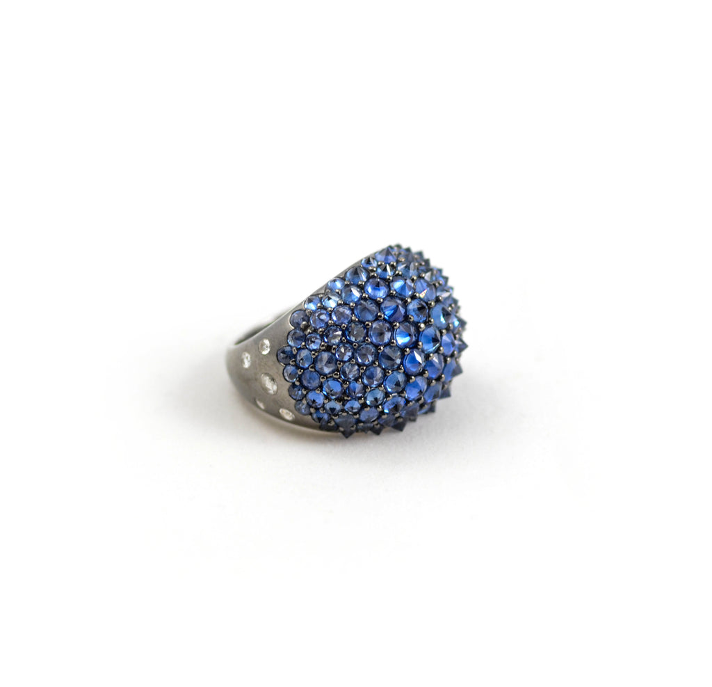 nam Cho jewelry spike ring in 18kt blackened white gold, reverse set blue sapphires and diamonds