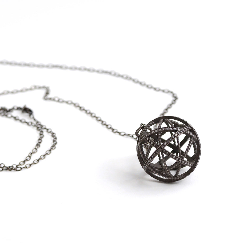 Nancy Newberg large oxidized silver and diamond ball pendant on black chain.