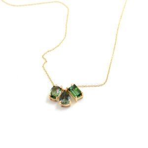"Nicole Landaw Necklace. Gorgeous green tourmaline necklace includes teardrop, oval and emerald cut pendants float gracefully on the 14kt yellow gold chain.   Pendant cluster measures approximately 5/8""x 1/4"". Chain is approximately 17""."
