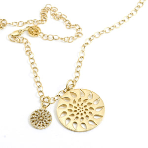 Phillips House signature diamond and gold pendants on oval link necklace.