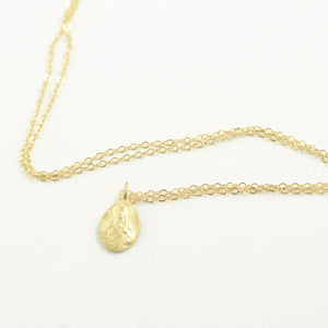 Robin Haley antiquities collection Tiny Christ necklace in 14kt yellow gold
