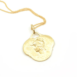 Robin Haley Artifact Collection Hermes pendant with diamond accented bale. 14 karat yellow gold