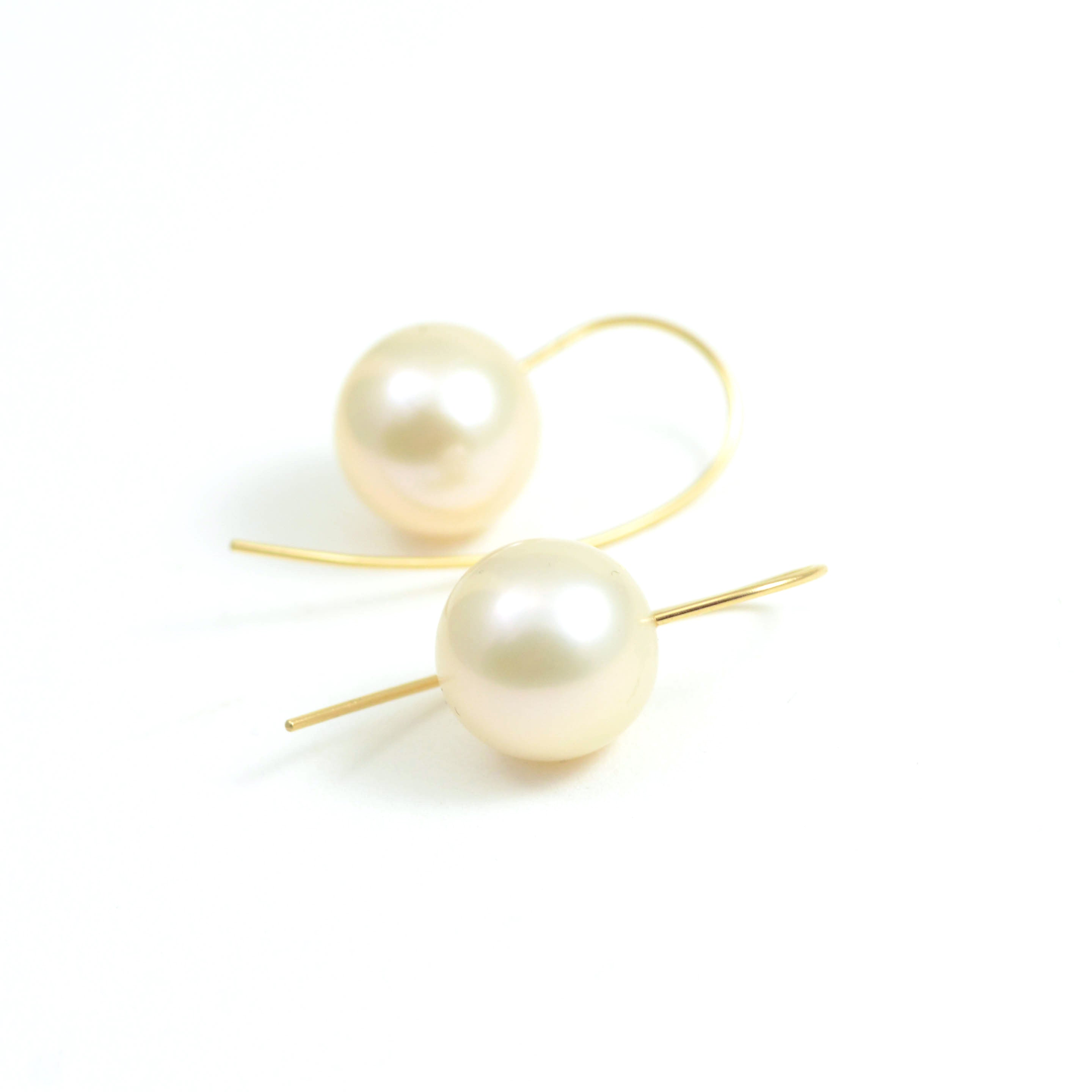 Fine Champagne South Sea Pearls on 18kt yellow gold French wire.