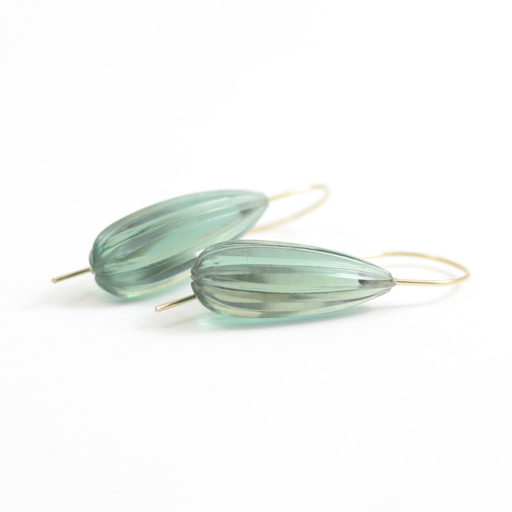 fluted green quartz are set simply on 18kt yellow gold French wire
