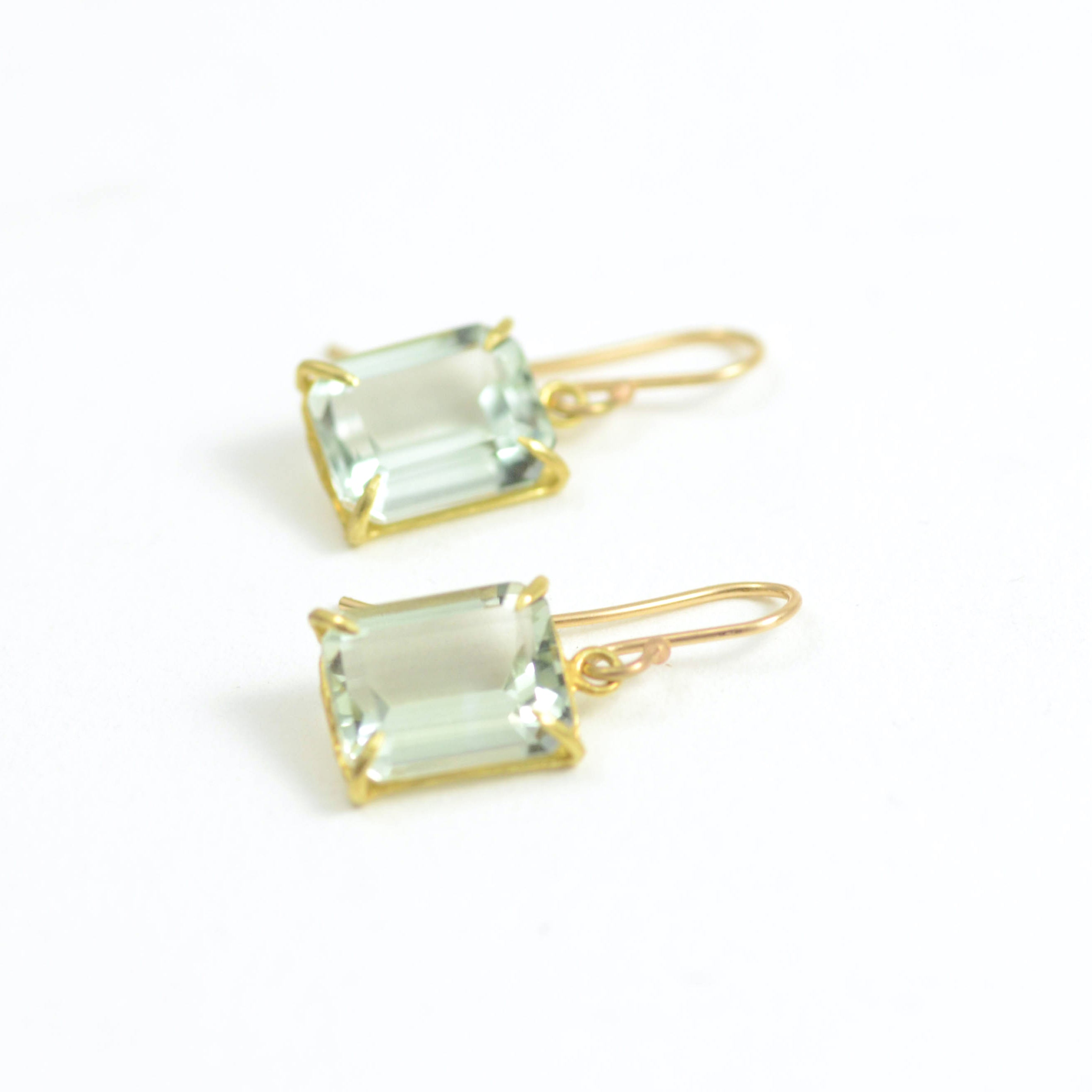 small emerald cut green amethyst in 18kt yellow gold on French wire. Also available in other stones.