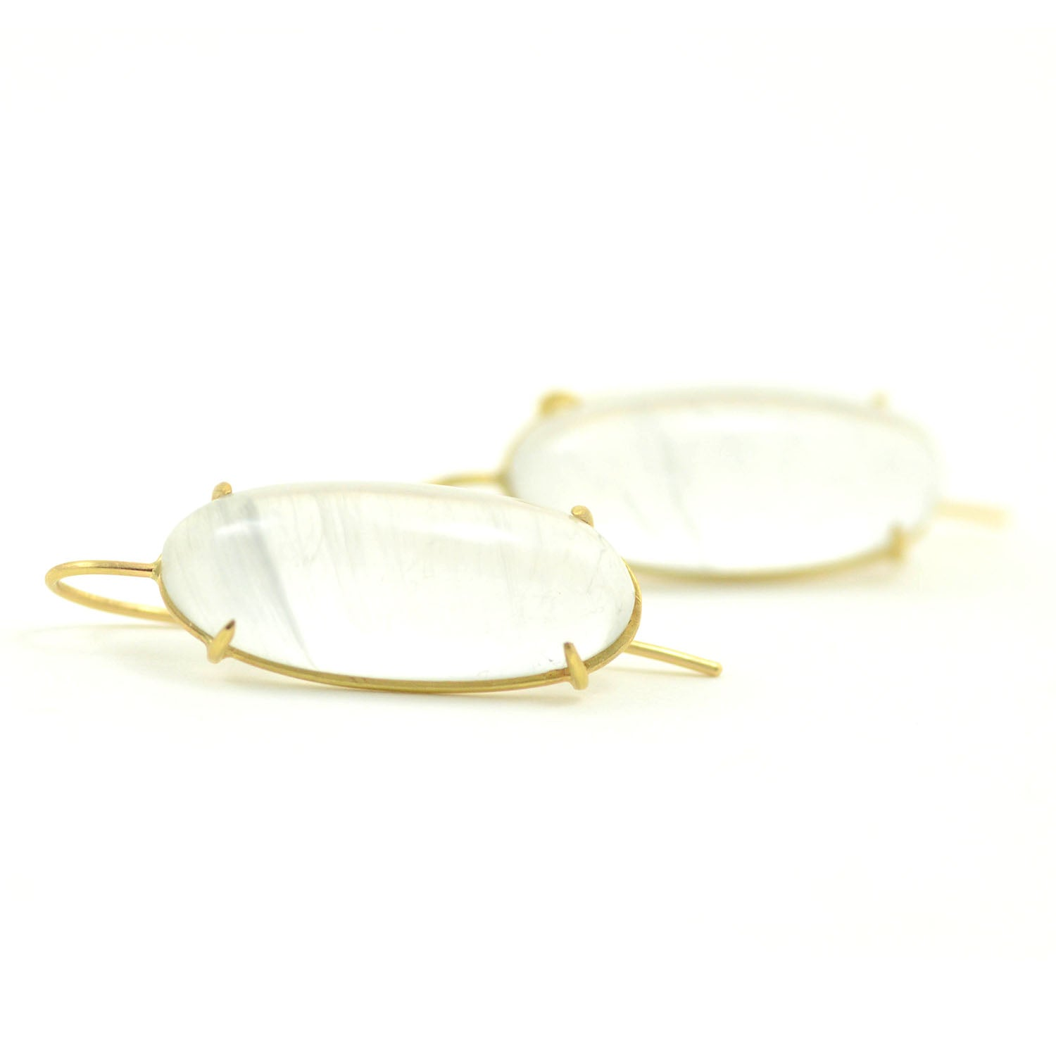 Rosanne Pugliese earrings of oval shapes luminous cabochon cut moonstones set in 18 karat yellow gold on minimalist earwires