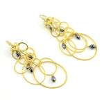 Rosanne Pugliese earrings 22 karat yellow gold oval link layered sculpture with faceted black diamonds French wire