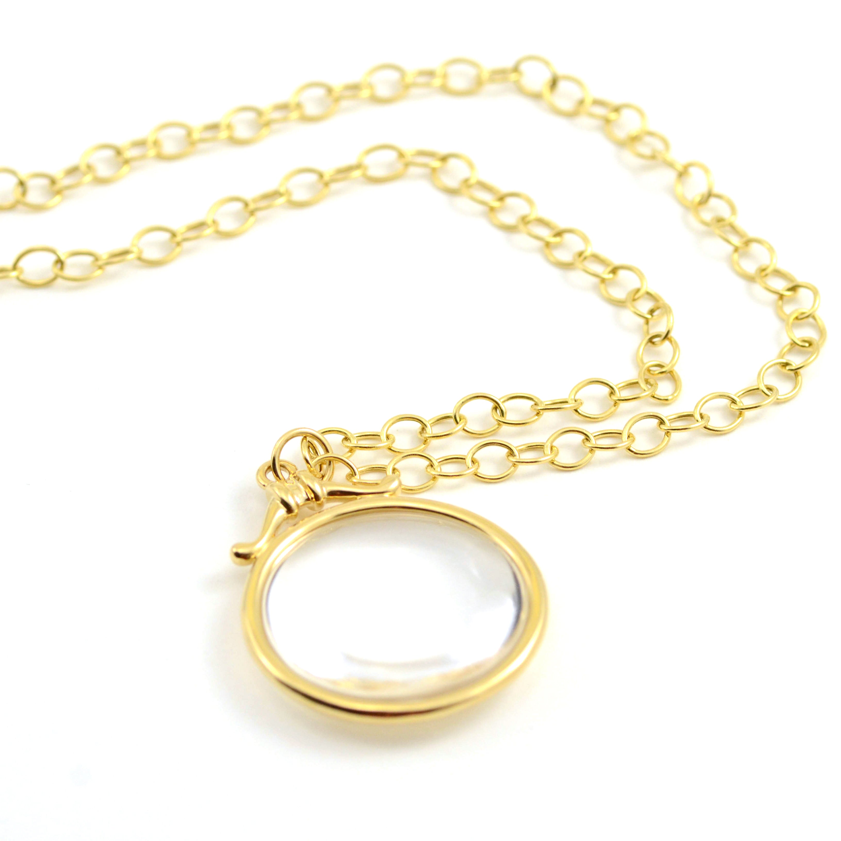 "Syna Necklace. Stunning Rock Crystal Chakra pendant is set in 18kt yellow gold. Shown with 18kt yellow gold oval link chain with lobster clasp. Simply stunning.   30mm pendant is 35 carats. Oval link chain is 30"". Necklace and Chain are available separately. Please inquire."