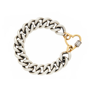 marla Aaron mega curb chain bracelet shown with stoned yellow gold heart with diamonds