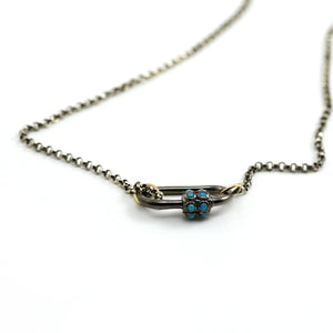 Marla Aaron Lock. This Stoned Medium Lock is Rhodium finished (blackened) 14kt white gold with 12 turquoise cabochons bezel set on the closure. shown with silver solo chain.
