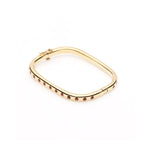 Moritz Glik orange sapphire yellow gold bangle bracelet