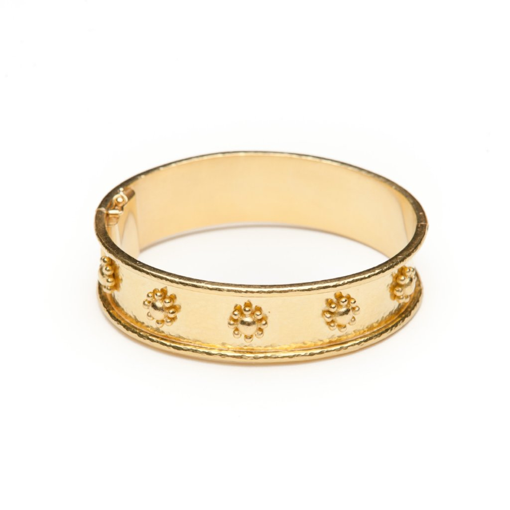 Elizabeth Lock jewels 19kt yellow gold bracelet. Has wide flat profile with daisy shaped details.