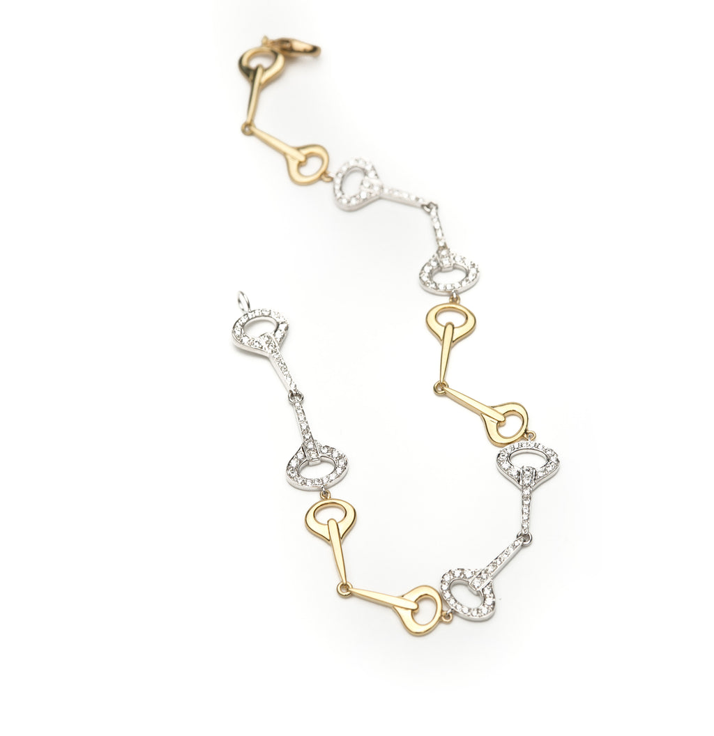 Gumuchian Bracelet. Comprised of 18 karat gold links and 18 karat white gold with pave diamond links, this delicate looking bracelet is perfect for every day wear.