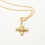 Robin Haley artifact collection Holy Spirit cross necklace in 14kt yellow gold.