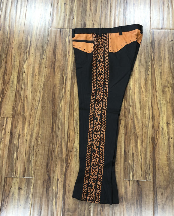 PANTALONES DE CHARRO. AUTHENTIC CHARRO PANTS THAT ARE DARK BROWN WITH ORANGE SUEDE LEATHER STITCHED STENCIL ART WORK