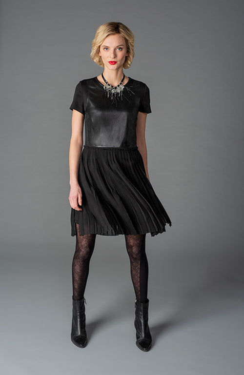 Knit and Faux-leather Dress with Pleated Skirt. Robe en tricot et faux cuir avec jupe plissée