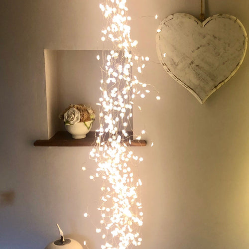 Silver sway cascade of LED star lights