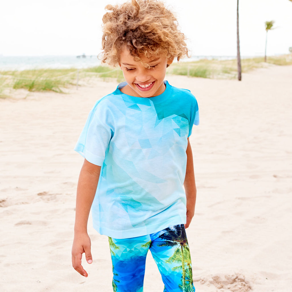 Kids Geometrical Graphic Tshirt Green Aqua Size Xs L Unisex Geo Tropical Smiling Boy At The Beach Looking Down Sunpoplife