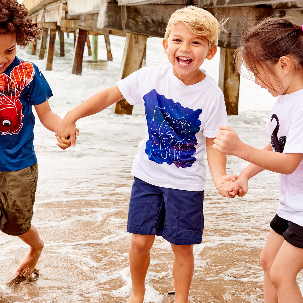 Kids Piggy Graphic Tshirt Size Xs L White Purple Unisex Cosmos Porcus Constellations Happy Boy Playing By The Pier With Friends Sunpoplife