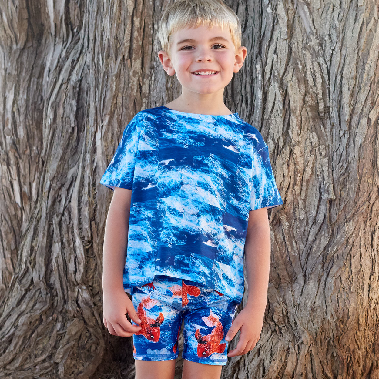 Kids Whitecaps Photo Tshirt White Blue Size Xs L Boy Standing In The Shade Smiling Sunpoplife