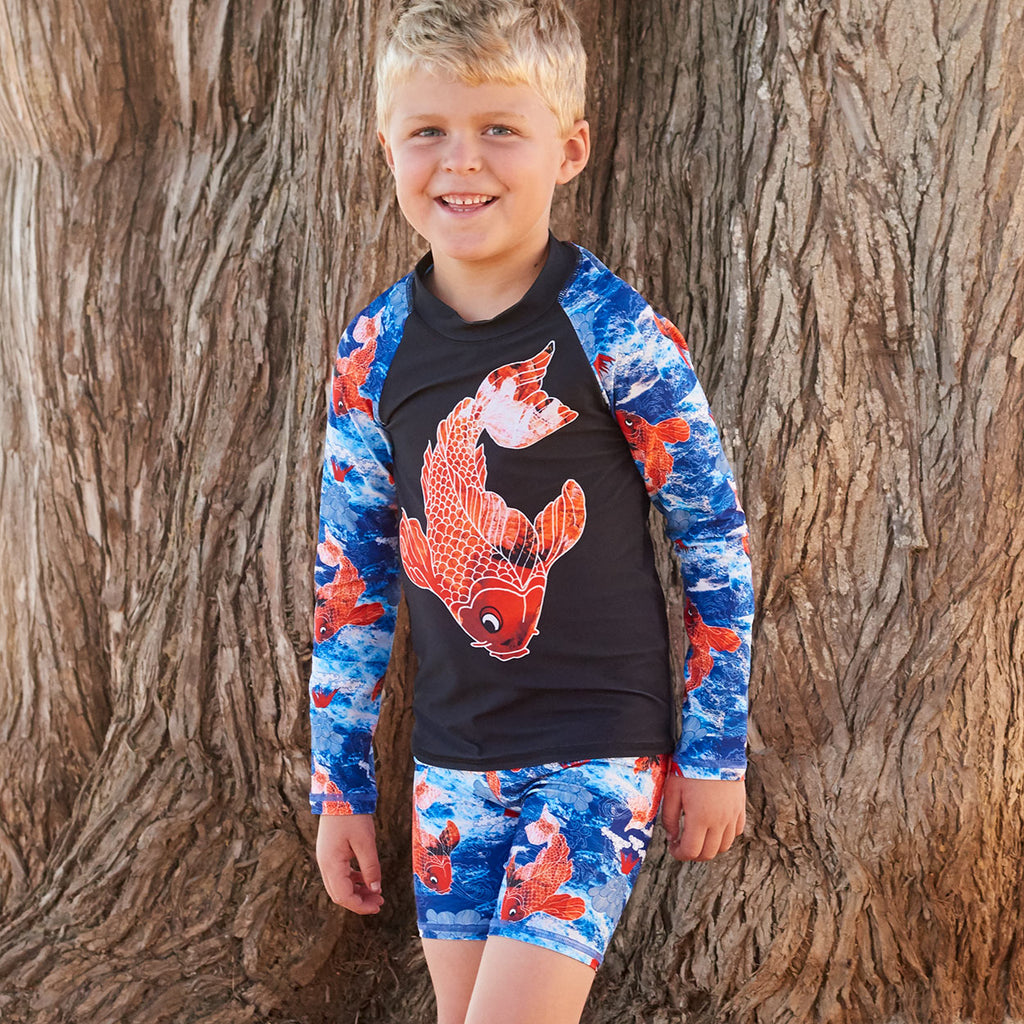 Koi Fish Long Sleeve Rash Guard Top Upf50 Kids Boys Size 2 12 Navy Blue Orange Happy Boy Leaning Against A Brown Tree Sunpoplife